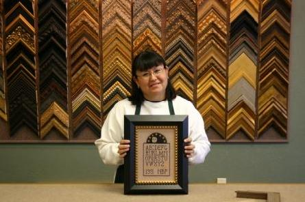 Carol Darling,of Plano TX, owns and operates Framing Memoreze and performs all custom framing and design